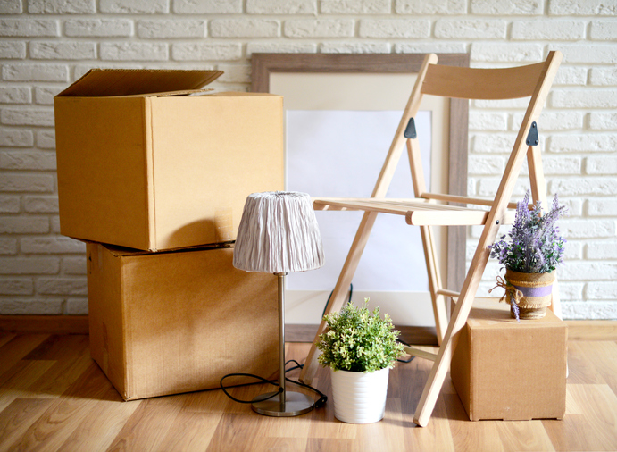cardboard boxes for moving, in an empty room, relocation and repair,